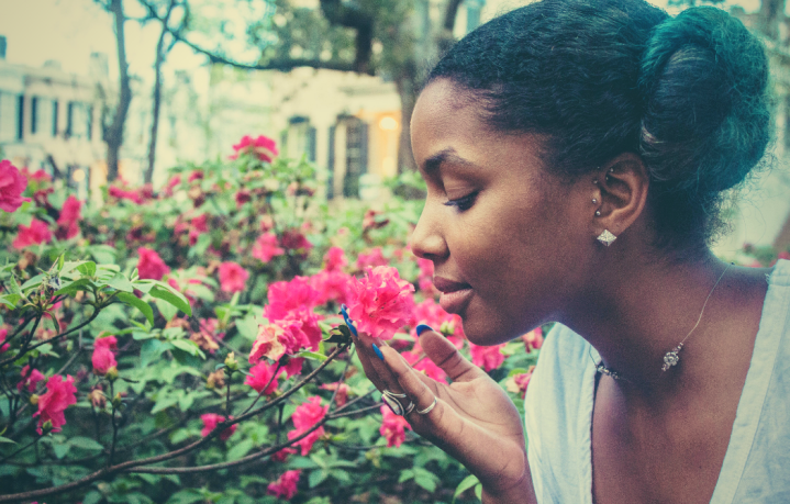 30 Life Lessons I've Learned in 30 Years Part Three Featured Image with Black Woman Smelling Flowers