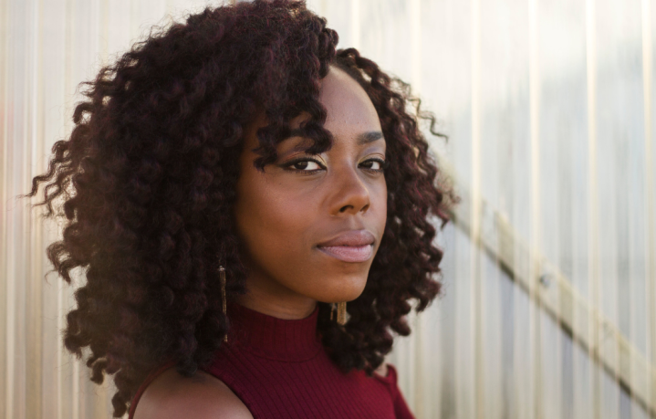 8 Things To Do When You Feel Like Giving Up Featured Image with Black Woman in Burgundy