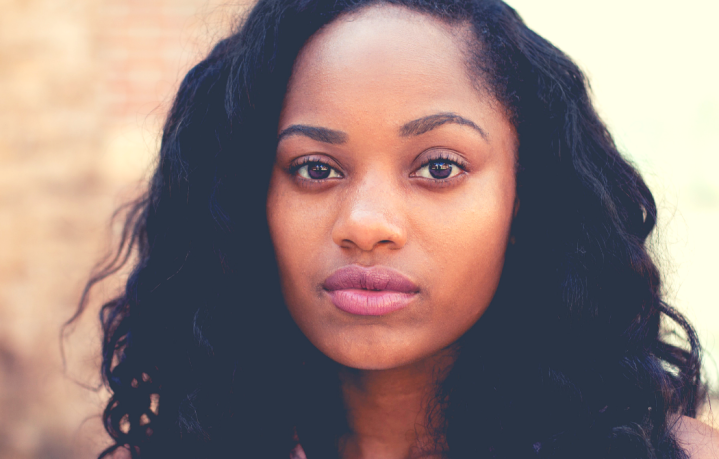 10 Things Heartache Taught Me Featured Image with Black Woman Looking Ahead