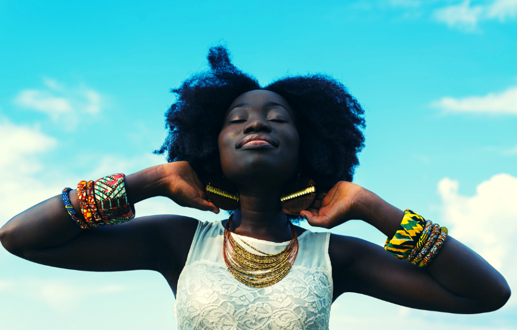 When You Need to Take a Break Featured Image with Black Woman Eyes Closed Towards the Sky
